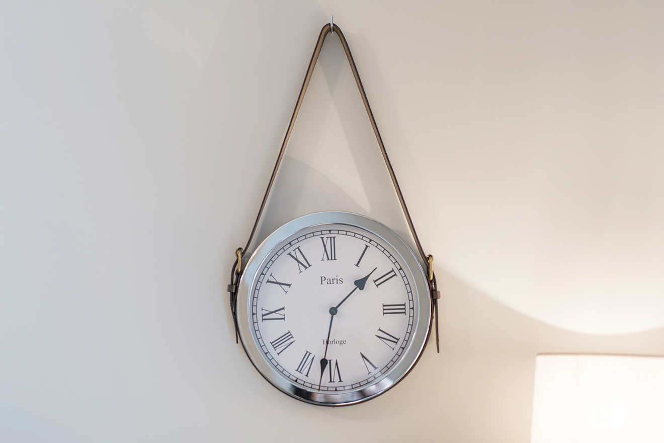 Paris clock on the wall of the Monthelie vacation rental offered by Paris Perfect