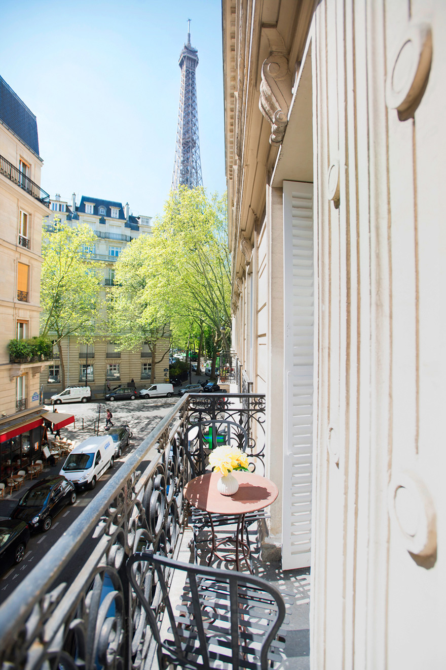 Leafy Eiffel Tower view from balcony of the Monthelie vacation rental offered by Paris Perfect