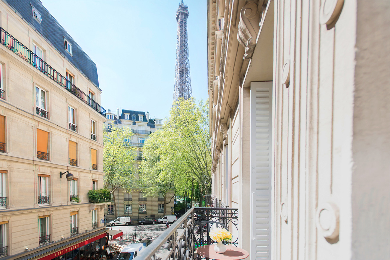 Balcony overlooks the Paris streets and beautiful Eiffel Tower at the Monthelie vacation rental