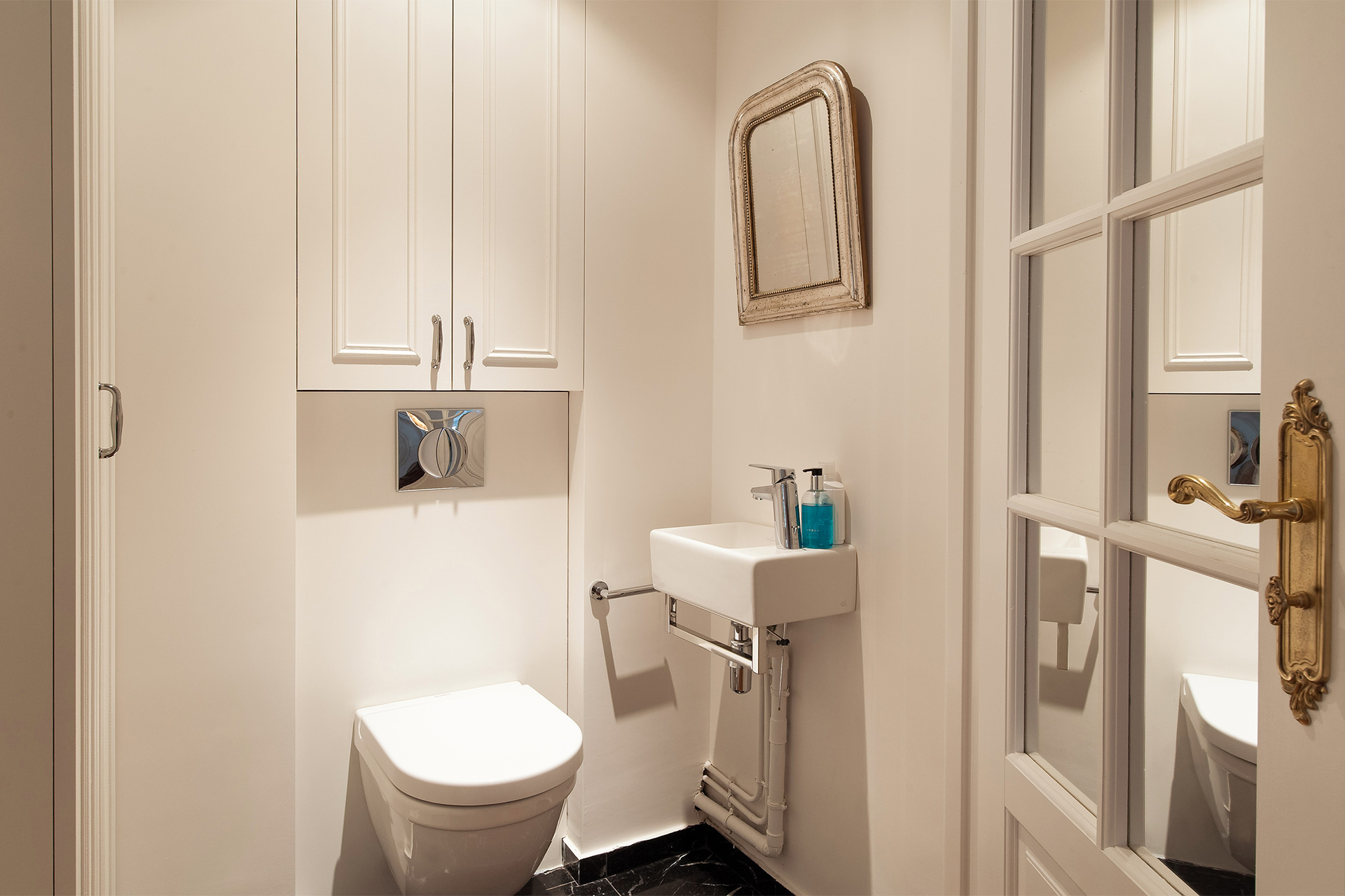 Half bath has a toilet and a sink in the Montagny vacation rental offered by Paris Perfect