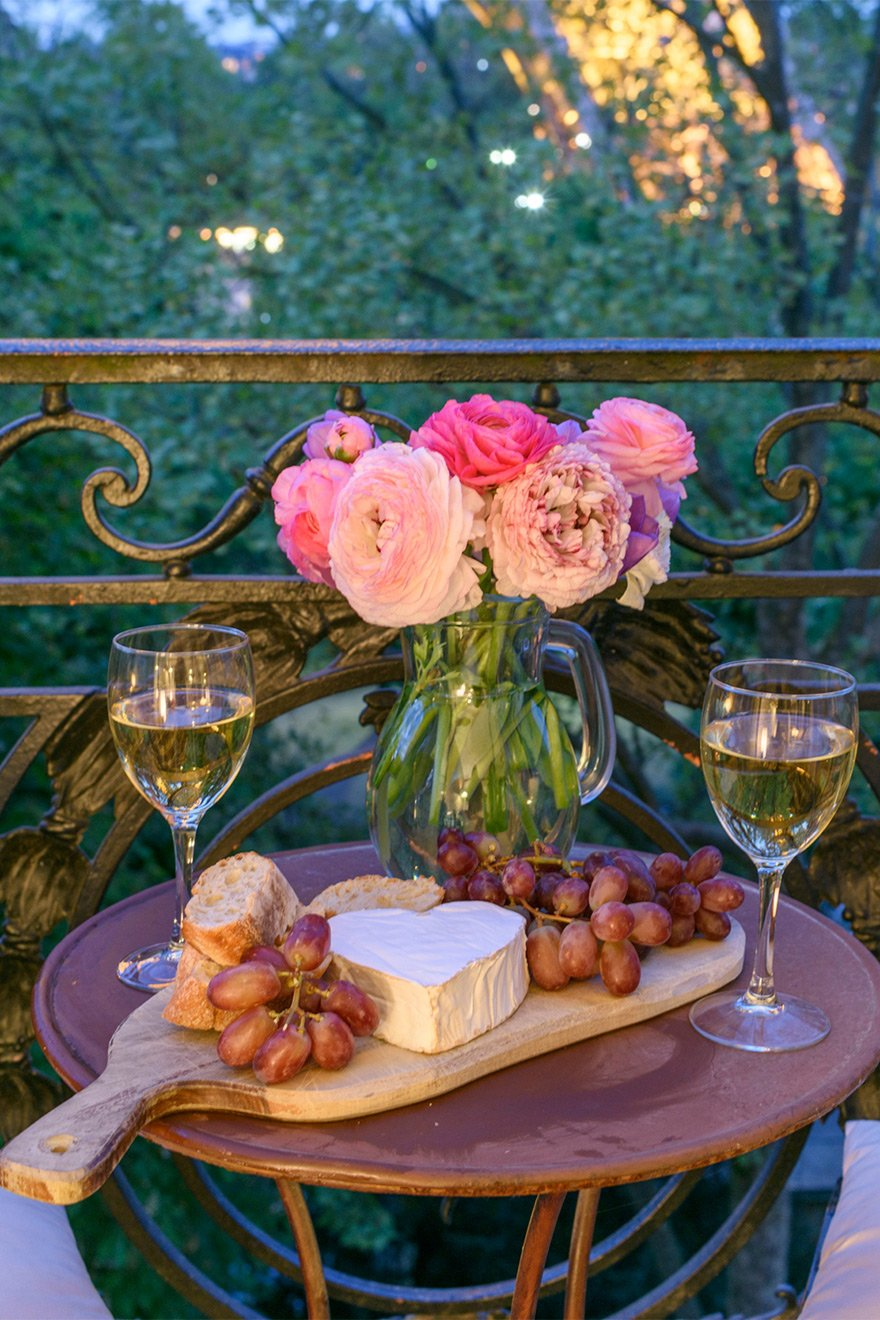 Cheese, grapes and wine on the balcony of the Viognier vacation rental offered by Paris Perfect