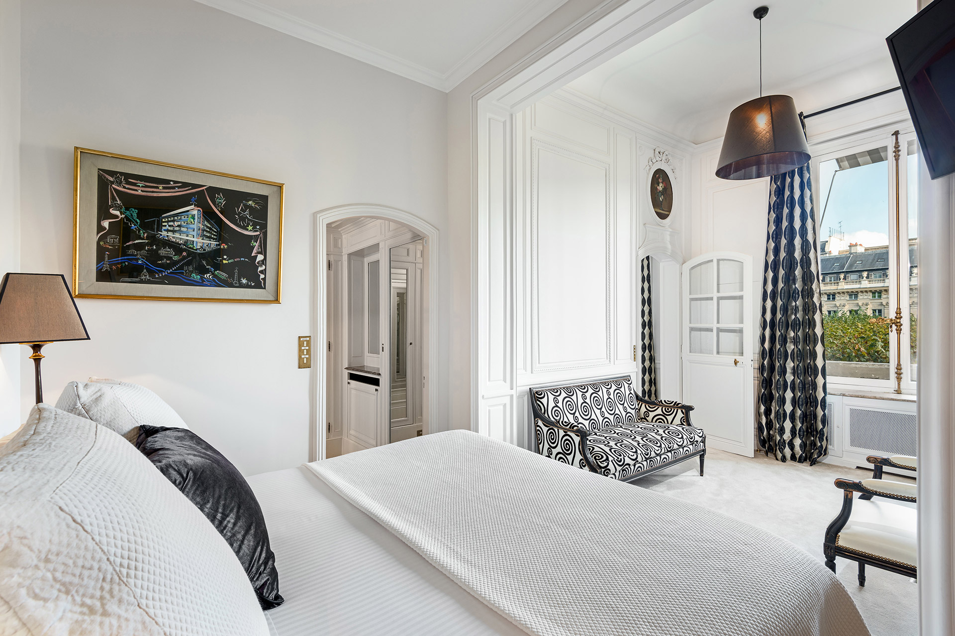 Wake up to Parisian views in the bedroom of the Chopine vacation rental offered by Paris Perfect