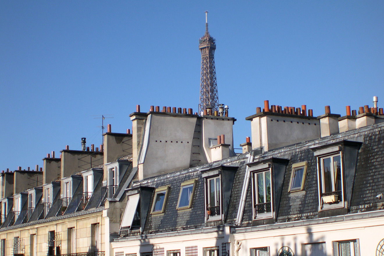 Sunny daytime view of the Eiffel Tower from the Pomerol vacation rental offered by Paris Perfect