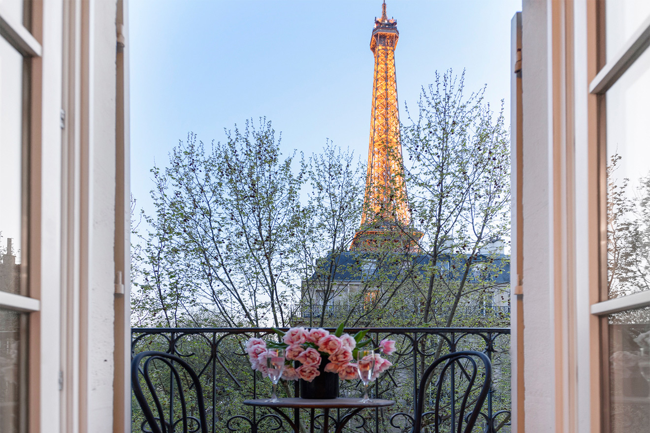 Watch the Eiffel Tower light up at sunset from the Calvados vacation rental offered by Paris Perfect