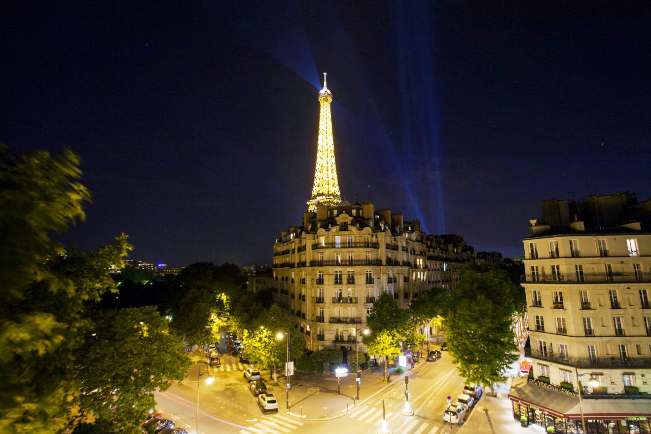 Amazing Eiffel Tower view at night from the Champagne vacation rental offered by Paris Perfect