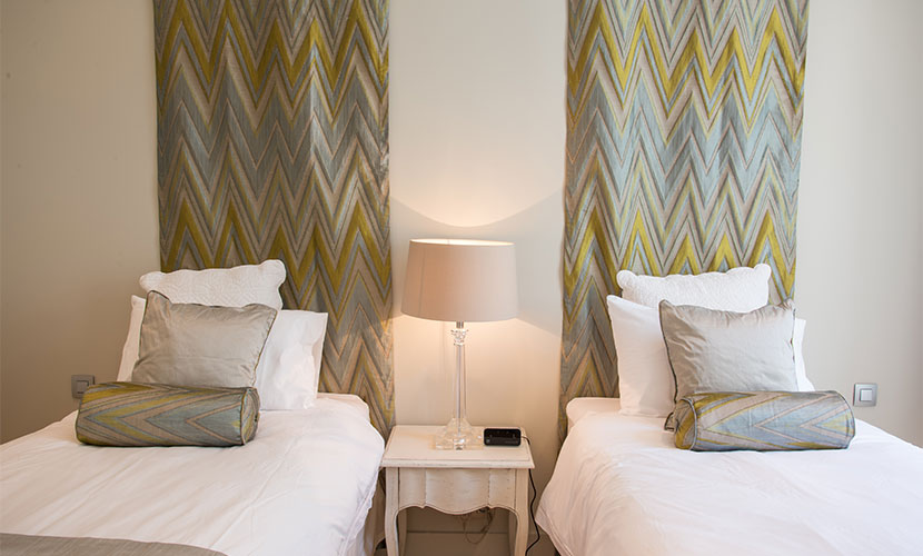 Fabric headboards in second bedroom
