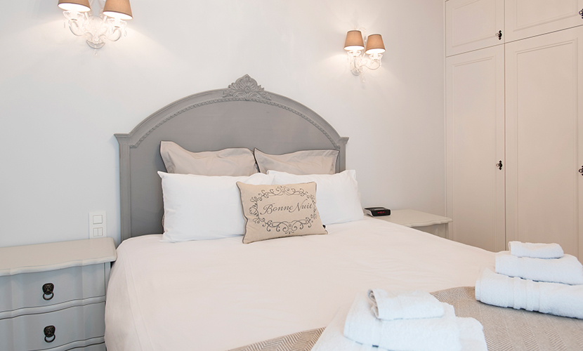 Soft hues in the first bedroom with extra wide queen bed in the Monthelie vacation rental offered by Paris Perfect