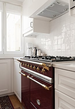 Vintage-style gas stove top and oven in the Montagny vacation rental offered by Paris Perfect