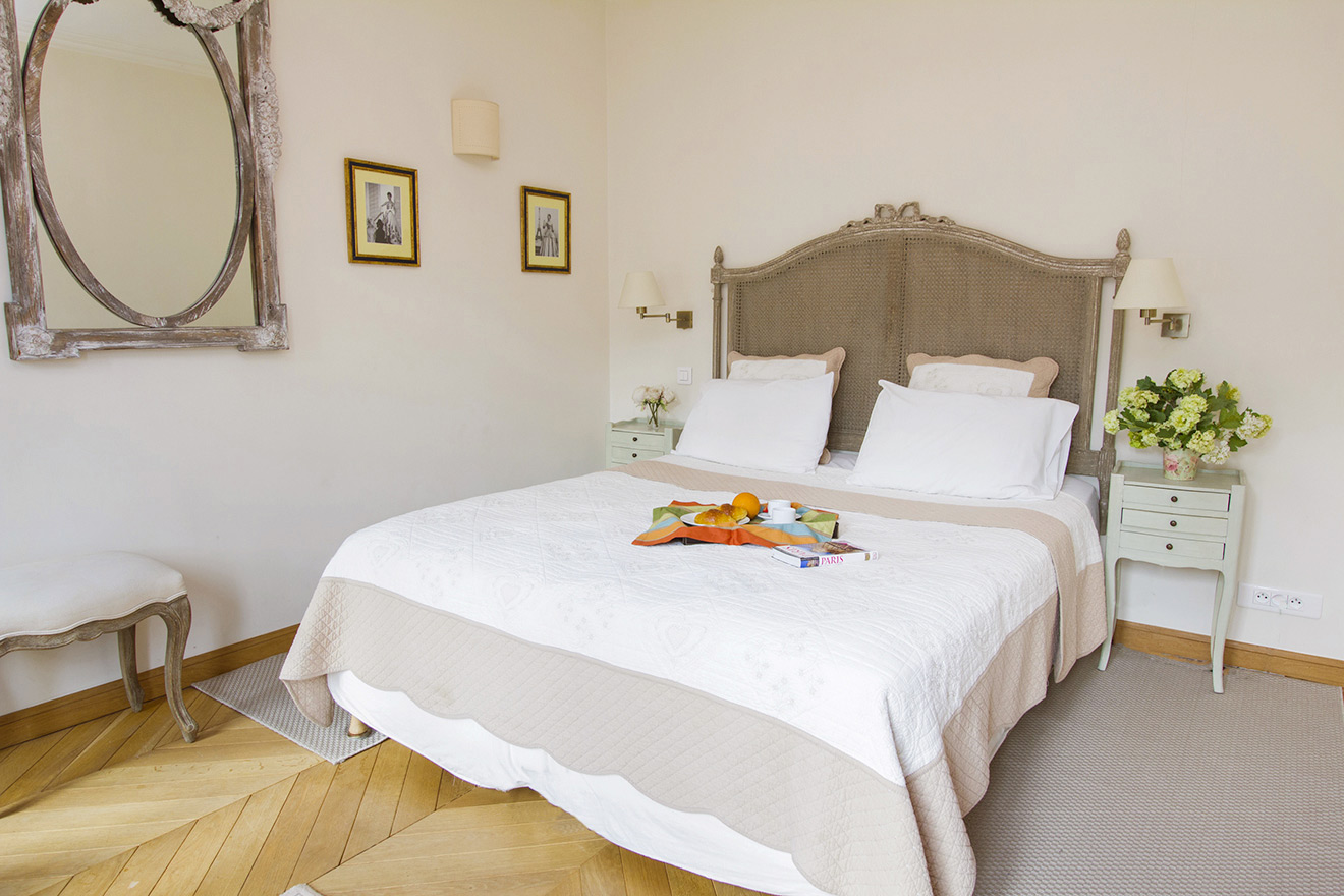 Bedroom with dual-extra wide queen bed and Eiffel Tower views in the Chablis vacation rental offered by Paris Perfect