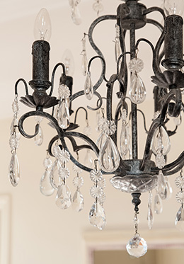 Glass chandelier over table