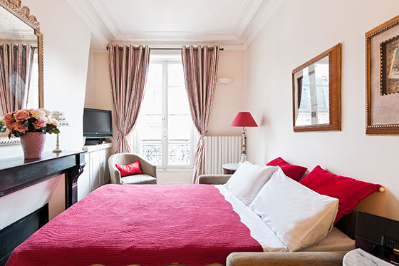 Sofa easily converts into a queen bed in the Vougeot vacation rental offered by Paris Perfect