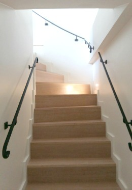 Stairs toward the living room in the Savennières vacation rental offered by Paris Perfect