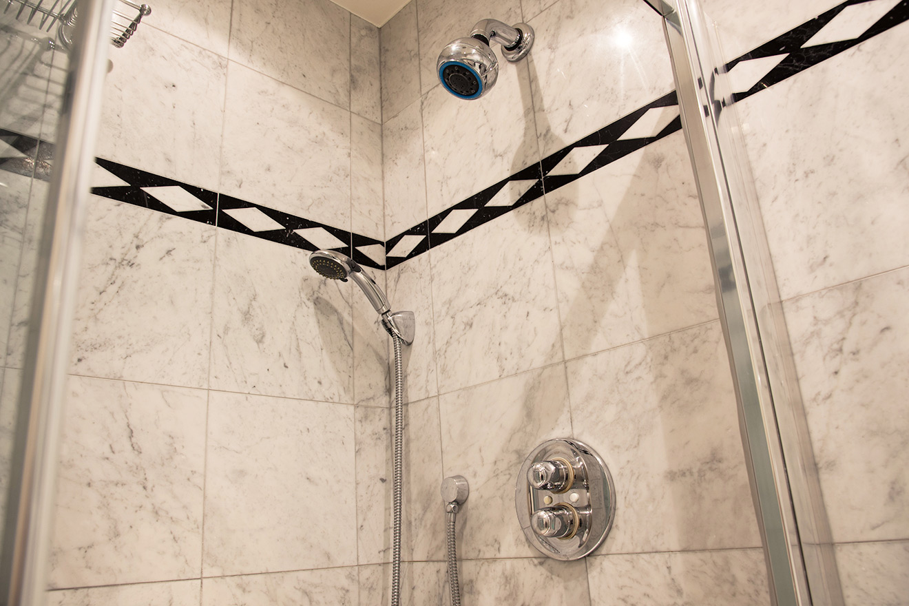The large shower in the bathroom of the Rully vacation rental offered by Paris Perfect