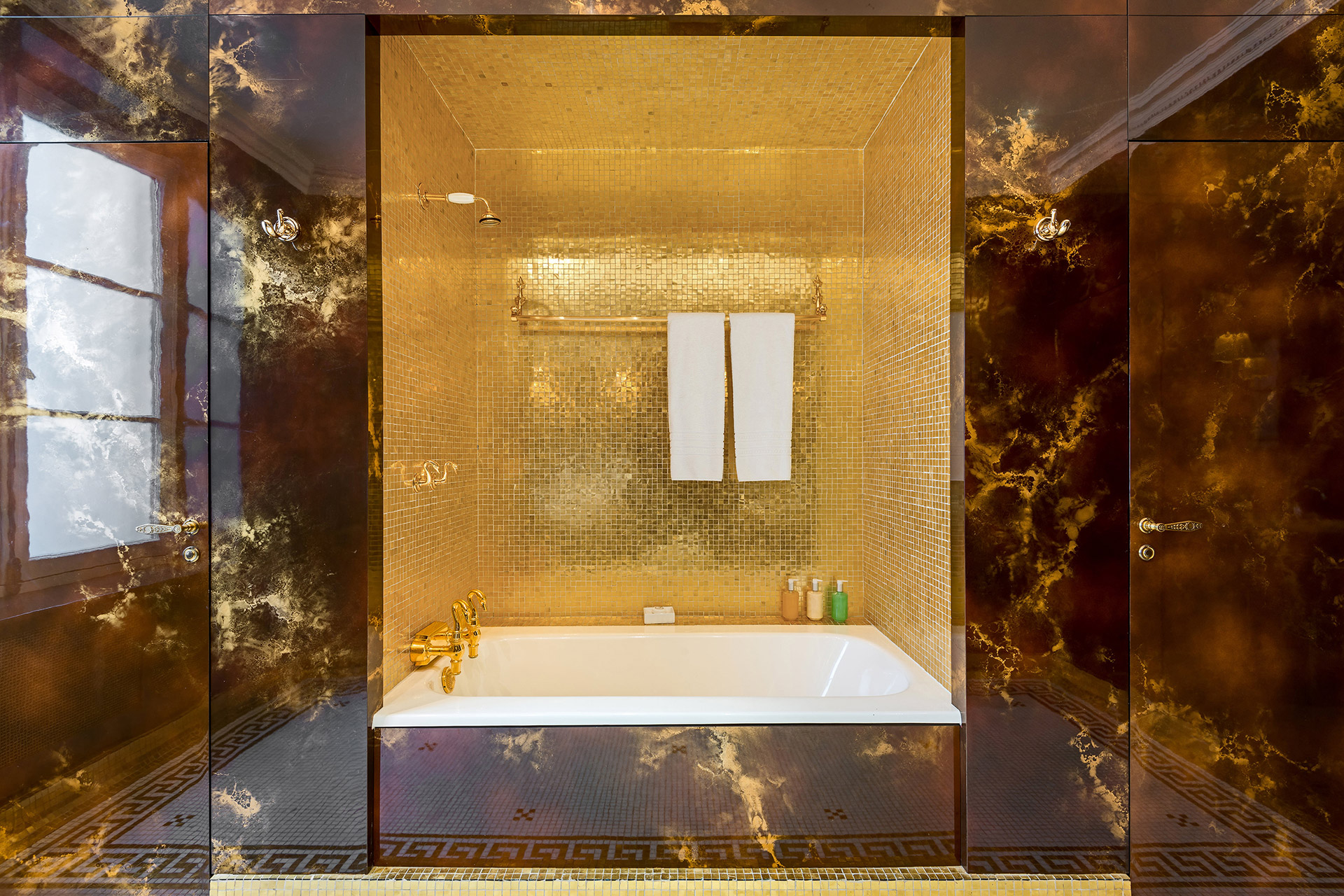 An irresistable royal soak in the bathroom of the Chopine vacation rental offered by Paris Perfect