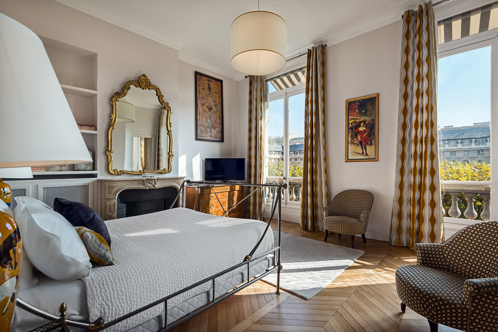 Designed for grandeur in the bedroom of the Chopine vacation rental offered by Paris Perfect