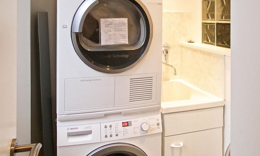 Laundry room with washer, dryer and sink