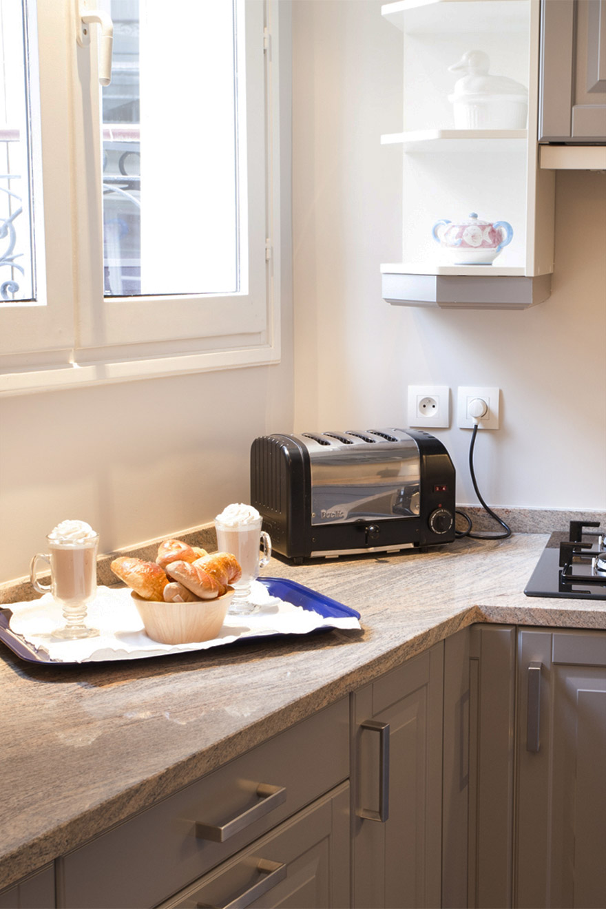 Toaster and breakfast in the kitchen of the Bordeaux vacation rental offered by Paris Perfect