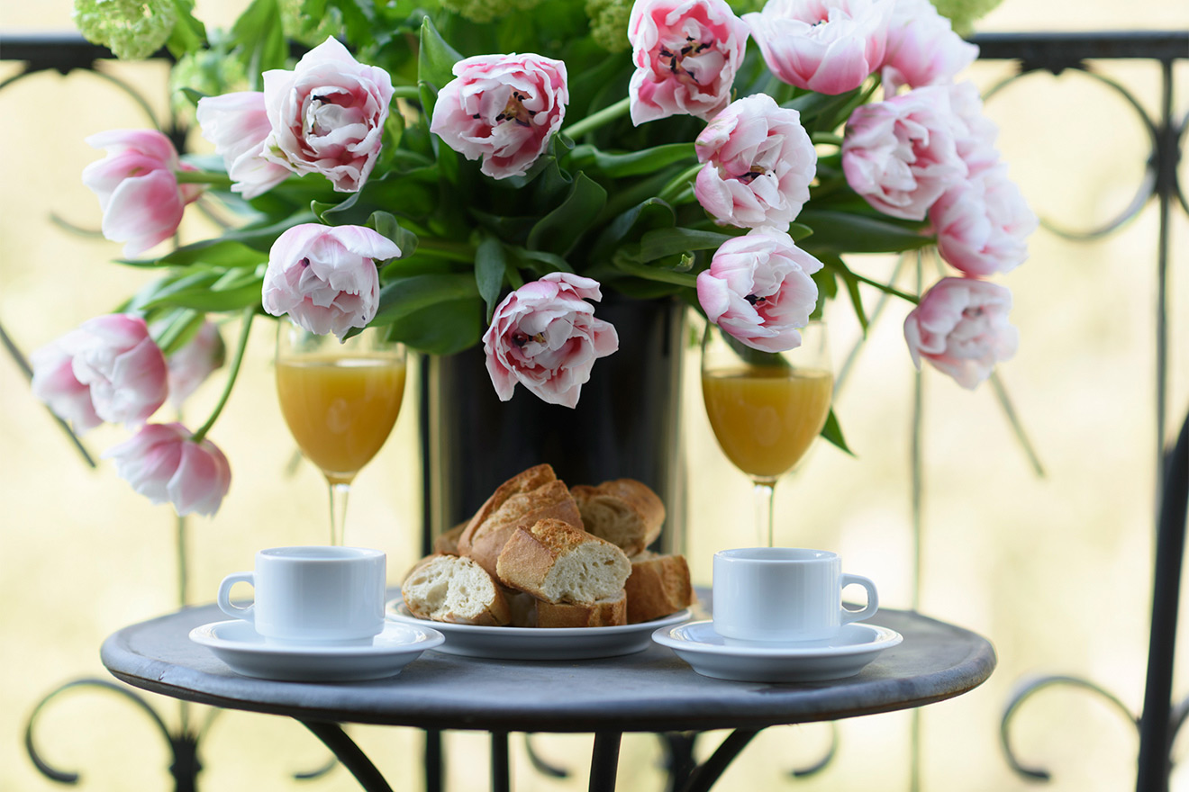 Breakfast on the balcony of the Calvados vacation rental offered by Paris Perfect