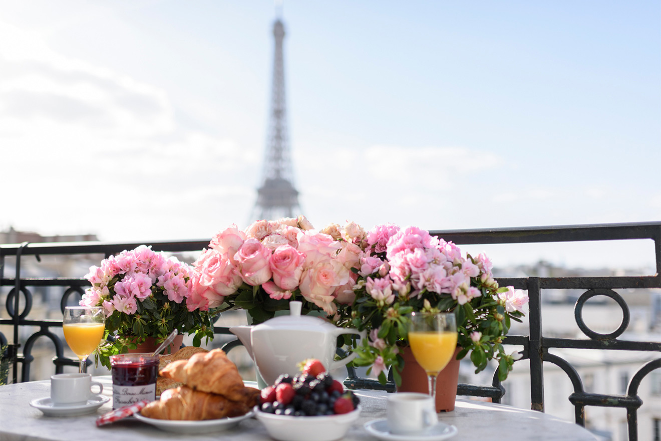 Al fresco breakfast on the balcony of the Chateau Latour vacation rental offered by Paris Perfect