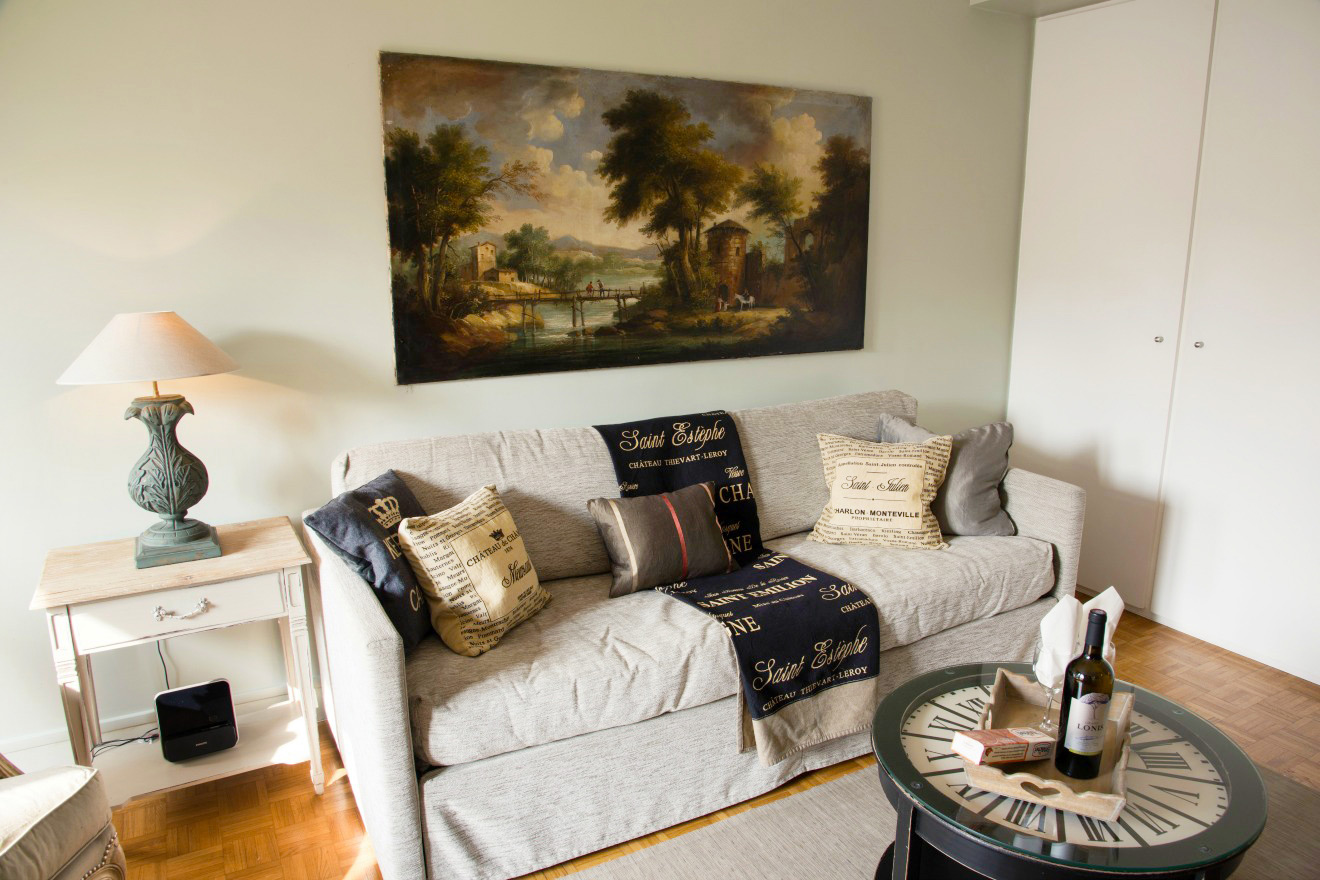 Long sofa beige black throw oil painting