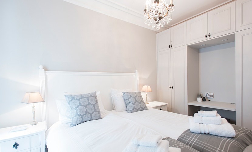 Design elements are soft and welcoming in second bedroom of the Monthelie vacation rental