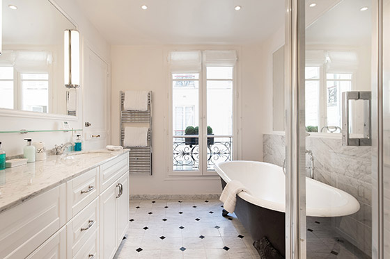 Take a hot bath in the black, clawfoot tub in the Montagny vacation rental offered by Paris Perfect