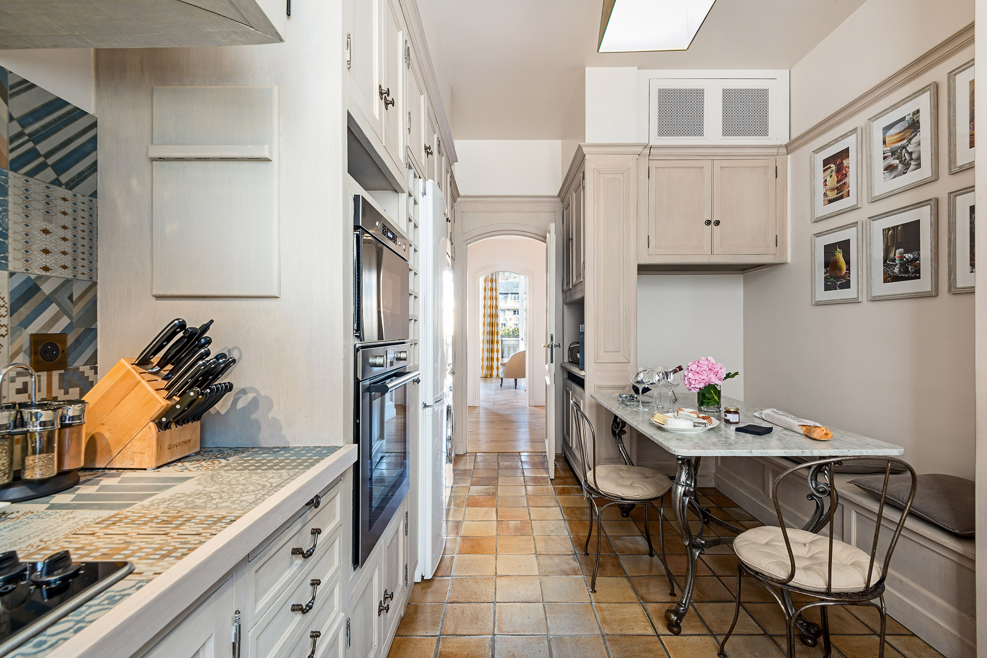Room for casual dining in the kitchen of the Chopine vacation rental offered by Paris Perfect