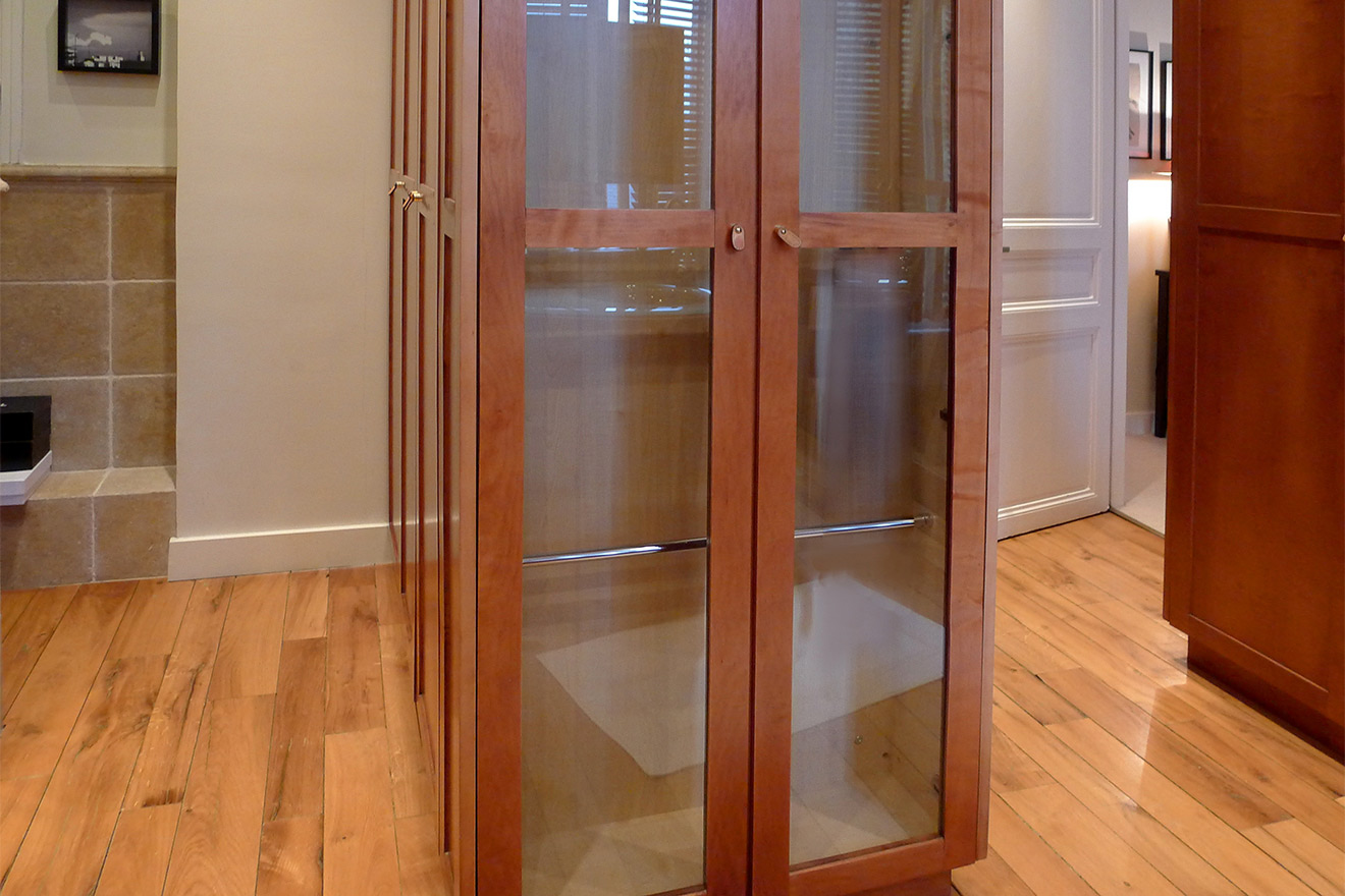 Glass doors in beautiful handcrafted walk-in closet