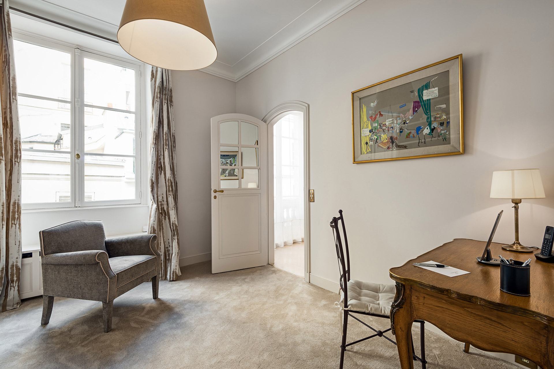 A perfect spot for reading and relaxing in the study of the Chopine vacation rental offered by Paris Perfect