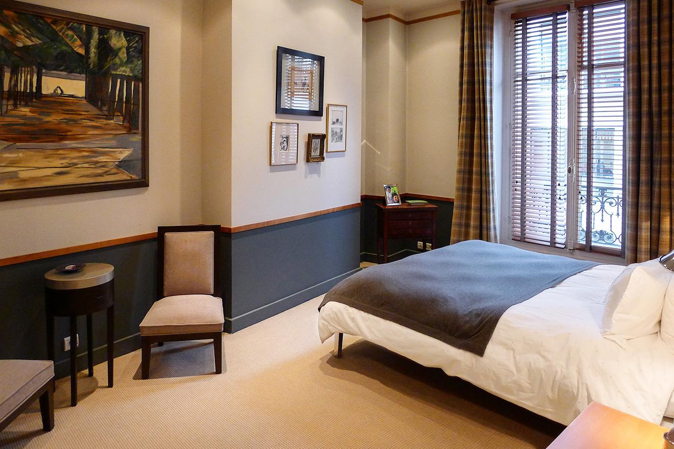 Elegant third bedroom with contemporary grey décor