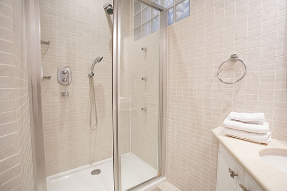 Third bathroom with large walk-in shower and sink in the Chateauneuf vacation rental offered by Paris Perfect