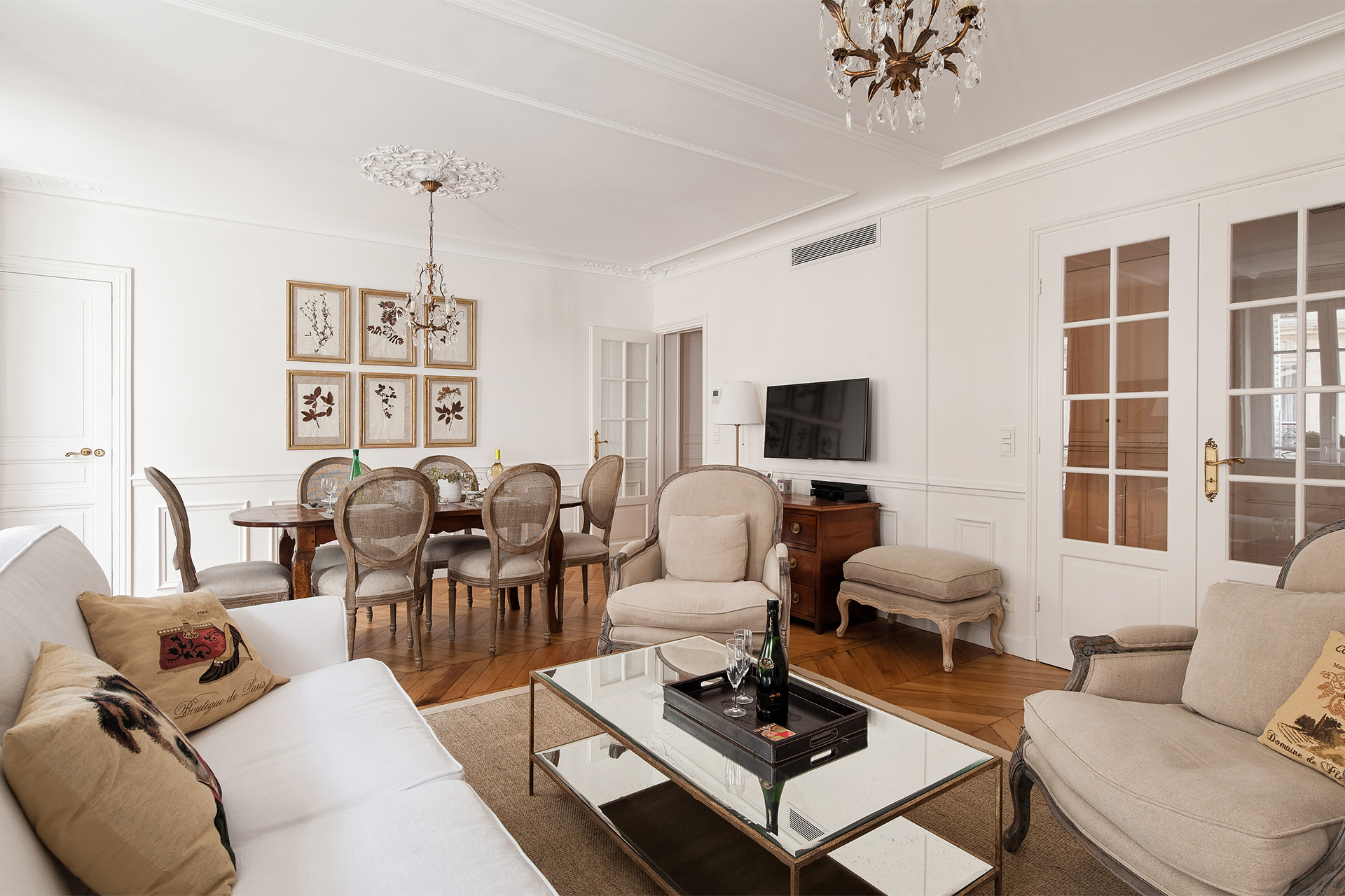 Open plan Living room and dining room of the Montagny vacation rental offered by Paris Perfect