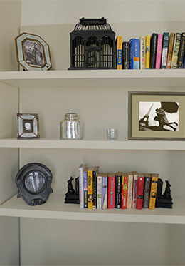 Built-in shelf filled with Parisian books in the Saumur vacation rental offered by Paris Perfect