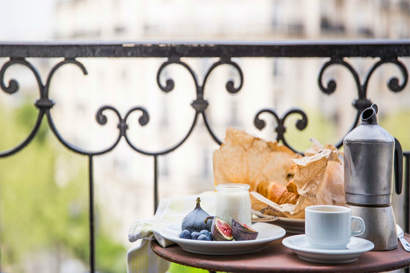 Breakfast on the sunny balcony of the Champagne vacation rental offered by Paris Perfect