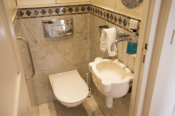 Half bath with toilet in the Champagne vacation rental offered by Paris Perfect