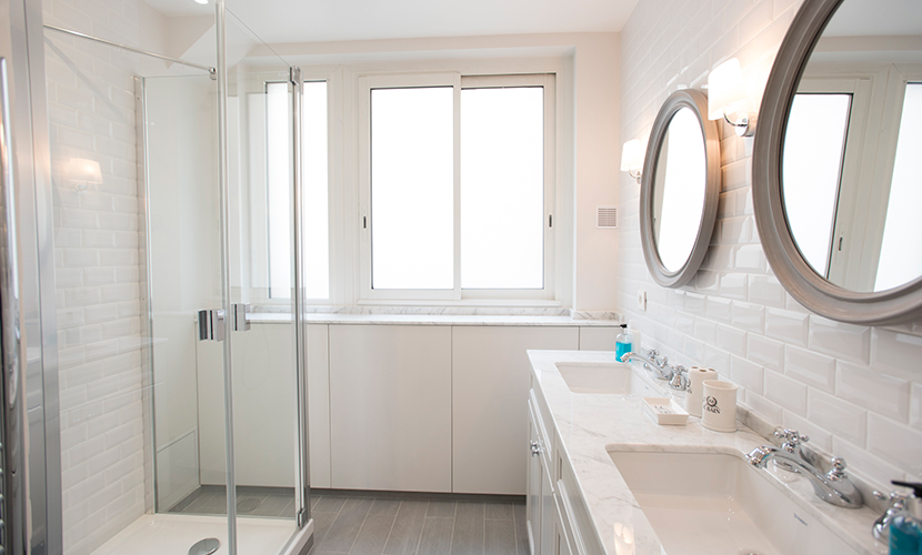 First bathroom with walk in shower in the Monthelie vacation rental offered by Paris Perfect