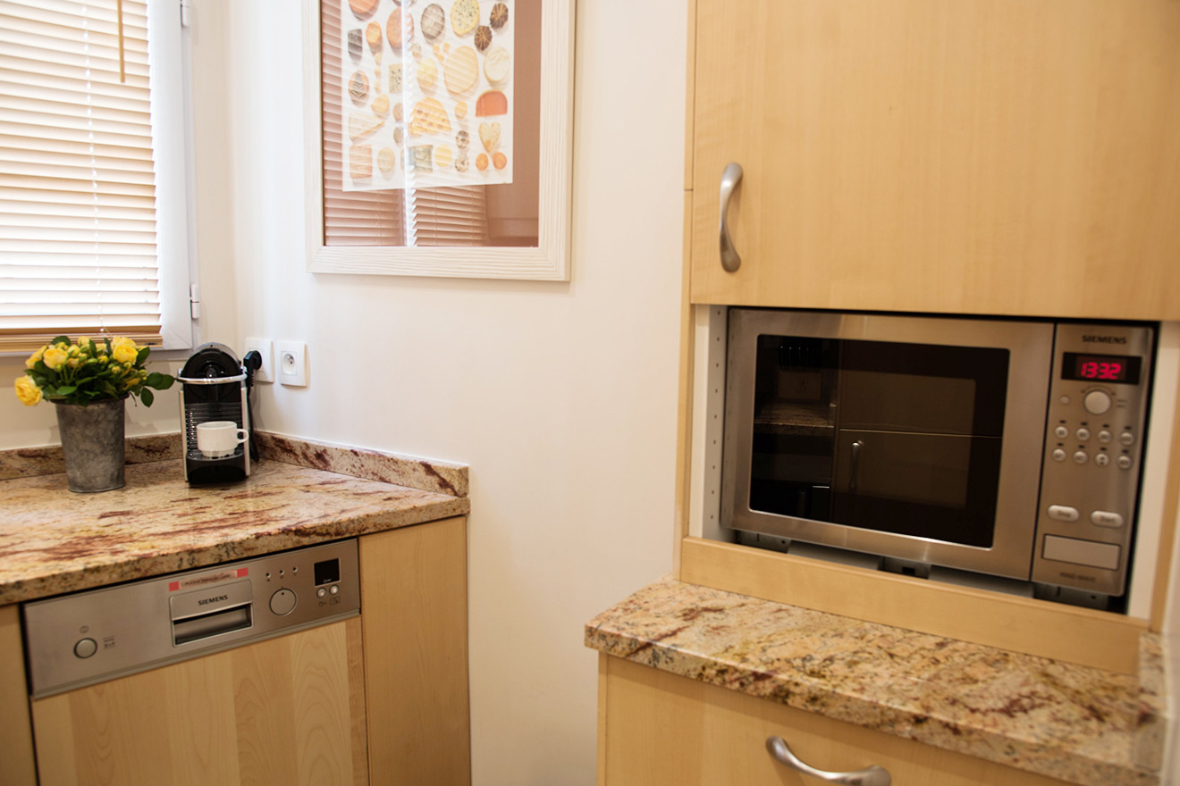 Microwave, dishwasher and nespresso machine in the Clairette vacation rental offered by Paris Perfect