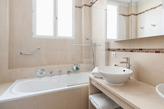 Enjoy a long hot soak in the tub in the Cognac vacation rental offered by Paris Perfect