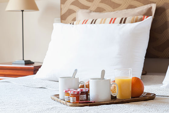 Breakfast of croissants and cappucino in bed in the Vougeot vacation rental offered by Paris Perfect