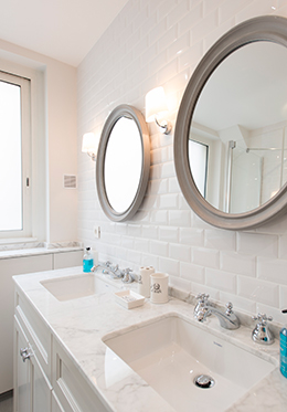 Cute circular mirrors in the Monthelie vacation rental offered by Paris Perfect