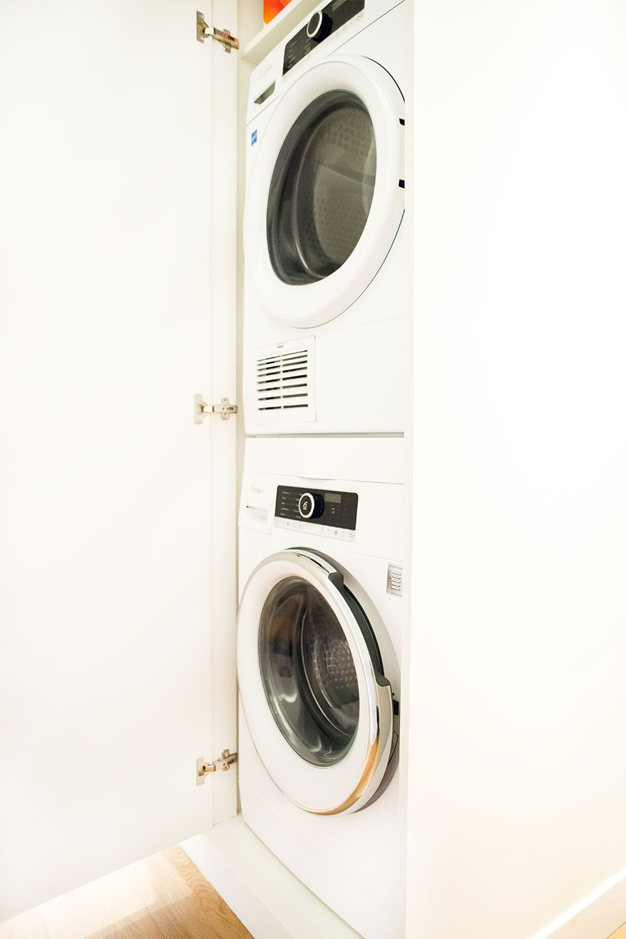Separate washing machine and dryer in the hallway at the Saint-Bris Paris Perfect rental
