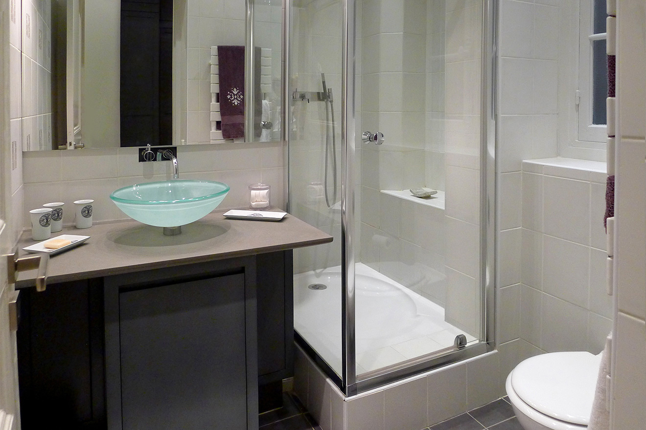 En suite third bathroom with shower, toilet and sink