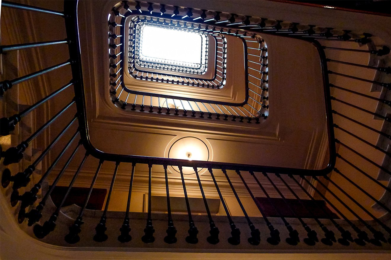Beautiful staircase in historic apartment building in Paris