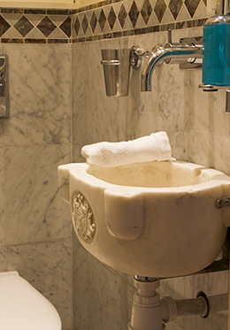 Antique stone hand basin in the half bath of the Champagne vacation rental offered by Paris Perfect