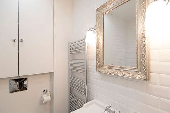 Antique mirror above the sink in the Monthelie vacation rental offered by Paris Perfect