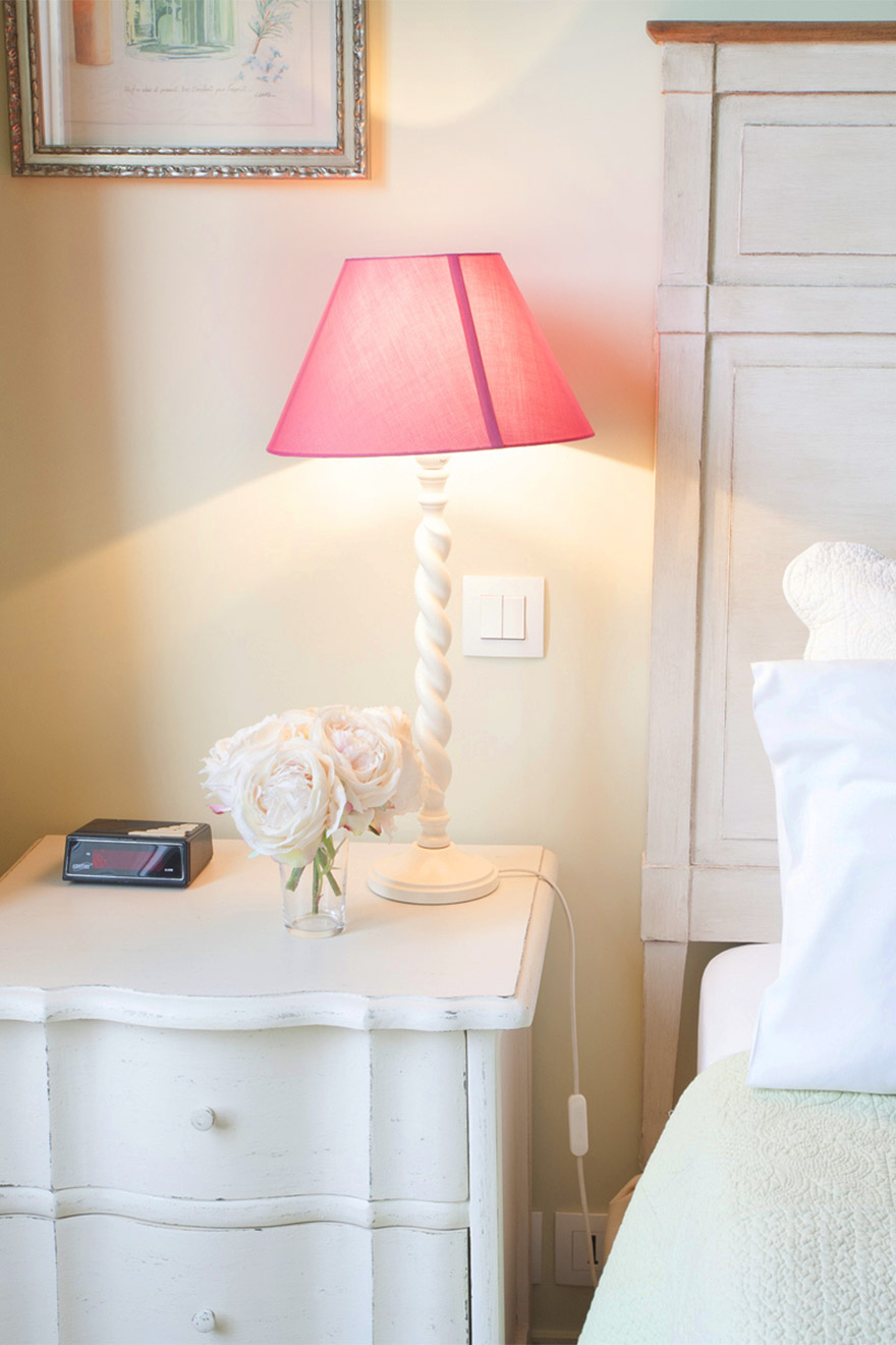 Pretty nightstands in the master bedroom of the Bordeaux vacation rental offered by Paris Perfect