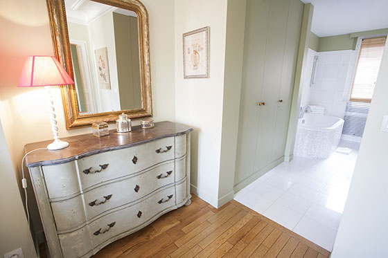 Antique dresser and built-in wardrobes in the Bordeaux vacation rental offered by Paris Perfect