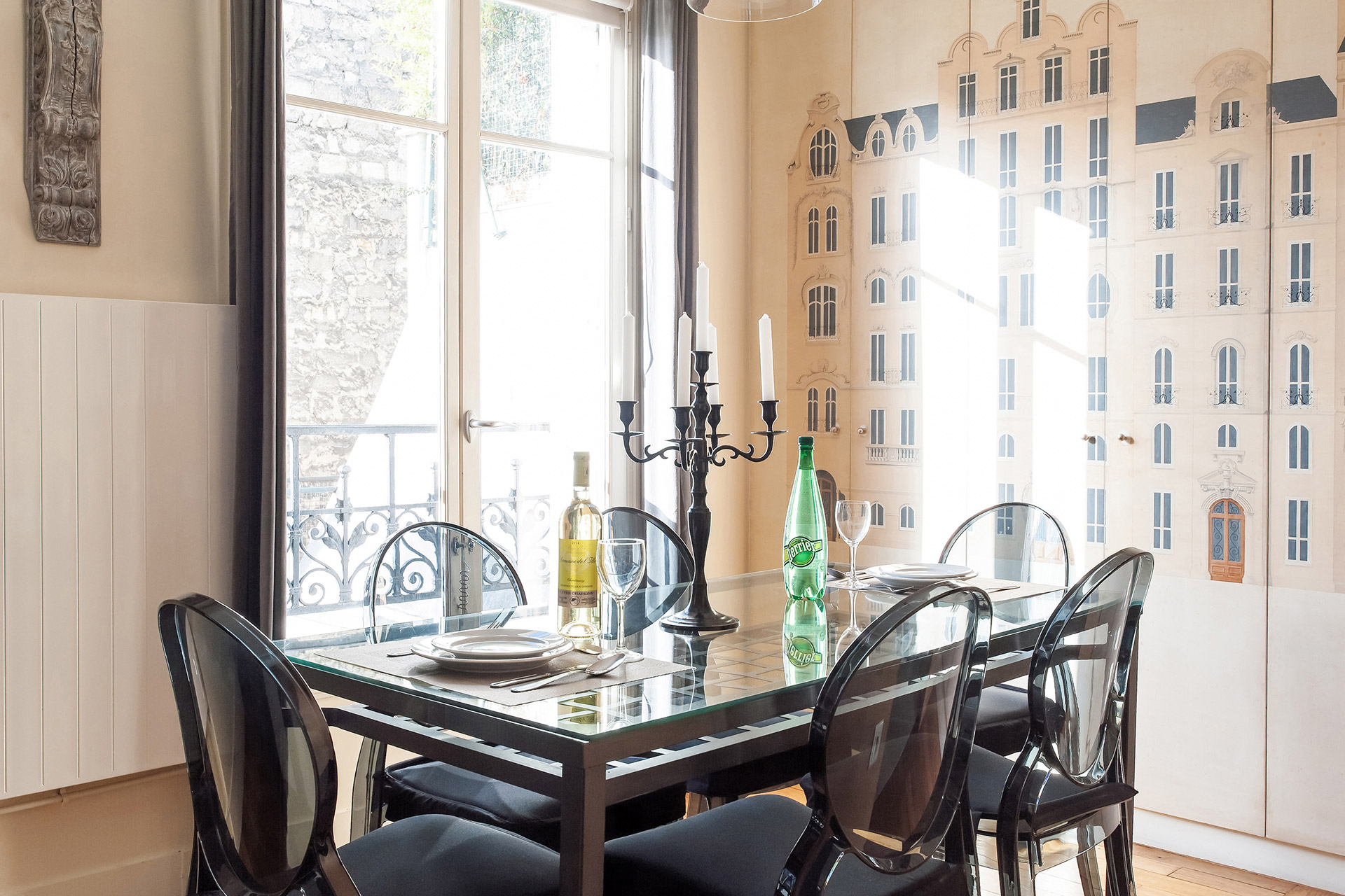 Dining table easily seats six people in the Romanée vacation rental offered by Paris Perfect