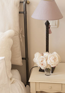 Pretty lamps on the bedside tables in the Cabernet vacation rental offered by Paris Perfect