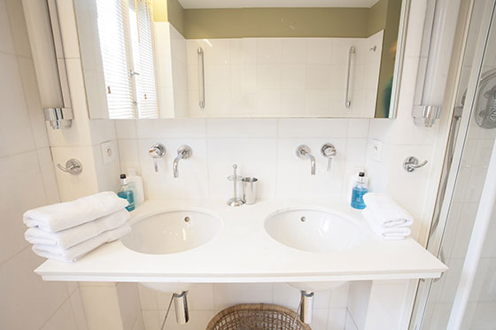 Double sinks in bathroom 1 of the Bordeaux vacation rental by Paris Perfect